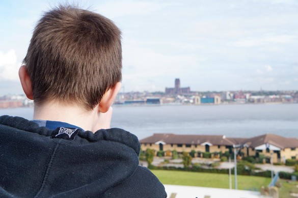 Boy looking across to Liverpool